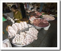 A meat stall specializing in intestines, ears, stomachs, livers, pancreas...