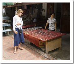 Lisa checking out the merchandise at a stall down Luang Prabang's main drag