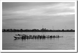 Rowers in the Mekong River