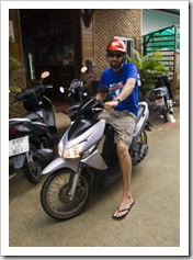 Sam on the little moped we rented for our time in Phuket