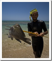 Sam catches Lisa a Yellowfin Bream for dinner on Ningaloo Station
