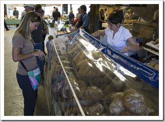 Lisa purchasing some of the awesome fresh bread on offer at the Boat Shed Markets