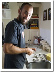Sam shucking oysters on the Brown's farm