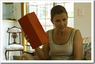 Lisa trying to guess a mystery gift