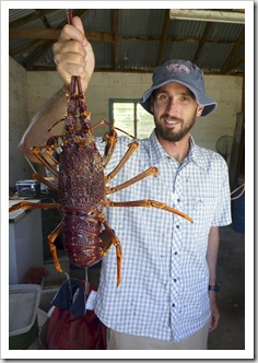 Sam and a monster crayfish at Al's cousin's farm