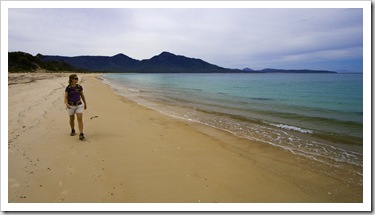 Lisa walking along Hazards Beach on our hike back from Wineglass Bay