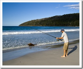 Sam fishing for Salmon Trout at Fortescue Bay