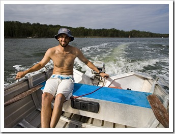 Sam piloting the dinghy around Lake Conjola