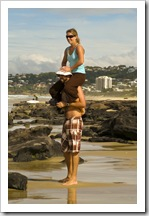 Lisa hitching a ride on Coolum Beach