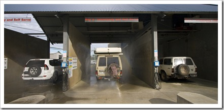 Peter, The Tank and Bessie getting an underbody wash in Rainbow Beach