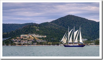 Sailing ship in for the night with Airlie Beach and Conway National Park in the background