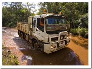 Trucks tackling the water crossings on Battle Camp Road