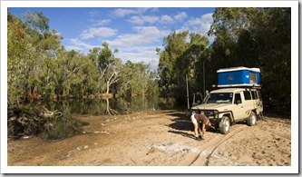 Lisa stretching after a lot of driving at our brilliant campsite on the banks of Emu Creek