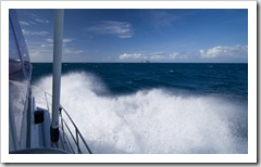 Rough seas on the way to the outer reef with North Direction Island in the distance