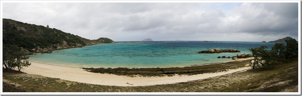 Panoramic of Trawler Beach and Blue Lagoon with North Direction Island in the distance