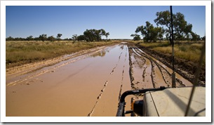 The Tank about to brave one of the deeper mud puddles on the way between Boulia and Bedourie